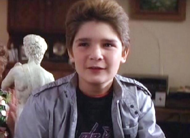 Corey Feldman in a Purple Rain shirt.  This is where the 80s imploded on itself.