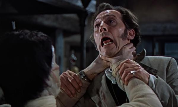 curse-of-frankenstein-hammer-horror-monster-creature-strangles-victor-peter-cushing-christopher-lee